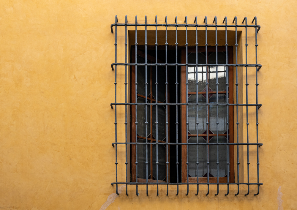 Large,Window,With,Traditional,Iron,Grille.